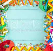 Empty frame for carnival on wood background