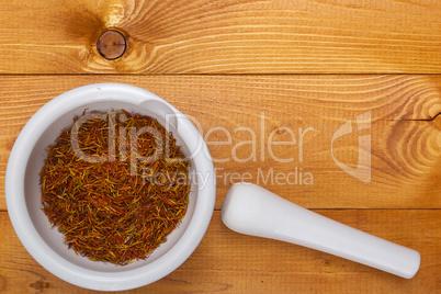 Culinary mortar with spice saffron