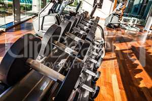 Dumbbells in the gym. Gym interior with equipment