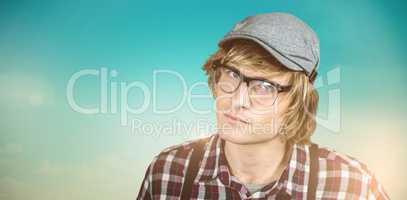 Composite image of serious blond hipster staring