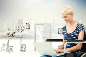 Composite image of woman in wheelchair using computer