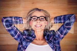 Composite image of gorgeous smiling blonde hipster lying
