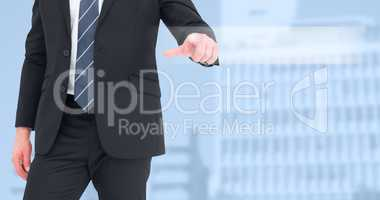 Composite image of mid section businessman pointing with his fin