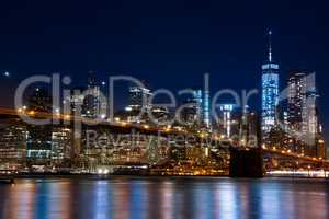 Manhattan and the Brooklyn Bridge. Evening