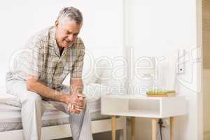 Suffering senior man waiting