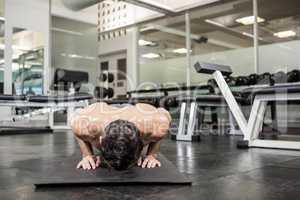 Shirtless man doing push up