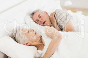 Awake senior woman in bed
