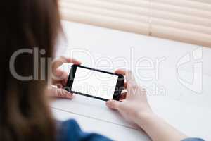 Close up view of businesswoman using her phone