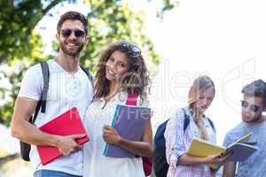Hip friends holding notebooks