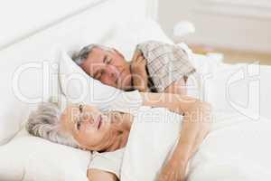 Mature woman awake in bed