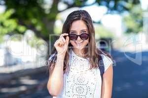 Hip girl holding her sunglasses