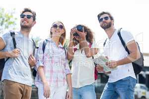 Hip friends visiting a city