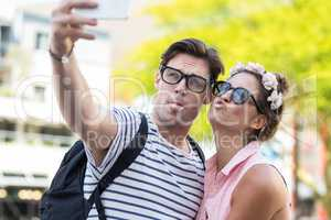 Hip couple taking selfie