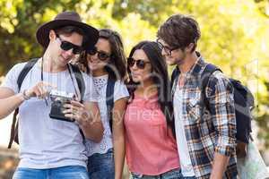 hip friends looking at digital camera