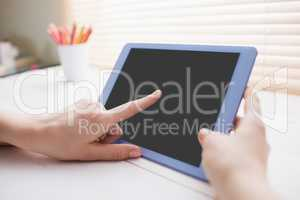 Close up view of businesswoman using her tablet