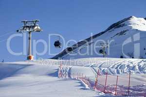Gondola lift on ski resort at sun day