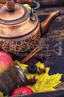 Copper kettle in retro still life