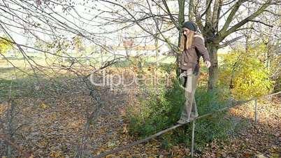 balancing on a railing