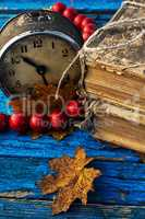old-fashioned alarm clock and coral beads