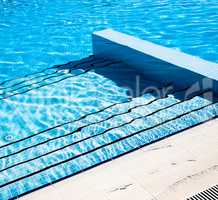 Stairs clear blue swimming pool