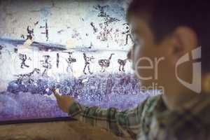 Child looks at aancient mural