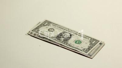 Hand putting dollar bills