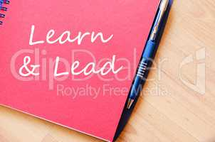Learn & Lead write on notebook