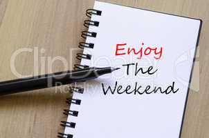 Enjoy the weekend write on notebook