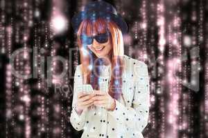 Composite image of smiling hipster woman texting with her smartp