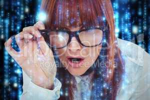 Composite image of smiling hipster woman holding her glasses