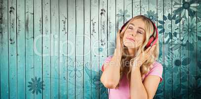 Composite image of pretty young woman with headphones