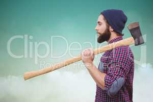 Composite image of side view of hipster with axe on shoulder