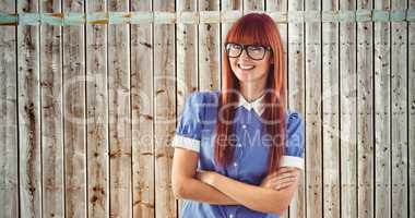 Composite image of attractive hipster woman with crossed arms