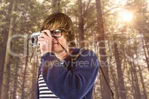 Composite image of hipster taking pictures with an old camera