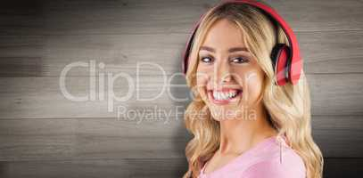 Composite image of portrait of a beautiful young woman with headphones