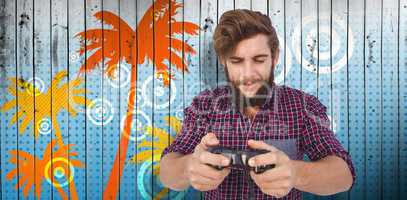 Composite image of hipster playing video game