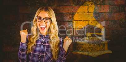 Composite image of gorgeous blonde hipster celebrating success