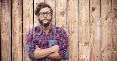 Composite image of confident hipster wearing eye glasses with ar