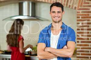 Portrait of young man smiling in kitchen