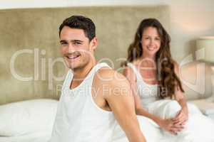 Portrait of young couple relaxing on bed