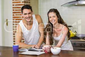 young couple checking their personal organizer in morning
