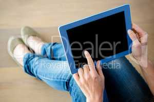 finger tapping a touchscreen tablet