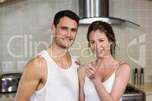 Young woman feeding breakfast to her man