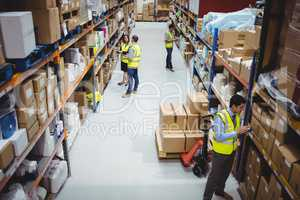 Warehouse worker using hand scanner