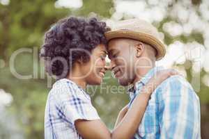 Peaceful couple standing nose to nose