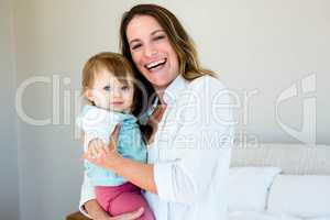 smiling woman holding an adorable baby