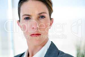 business woman staring into the camera