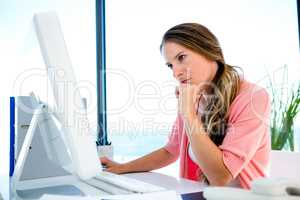 concerned businessWoman staring worriedly at a computer