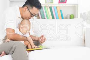 Father and child reading story book