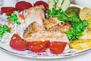 Baked fish and vegetables .